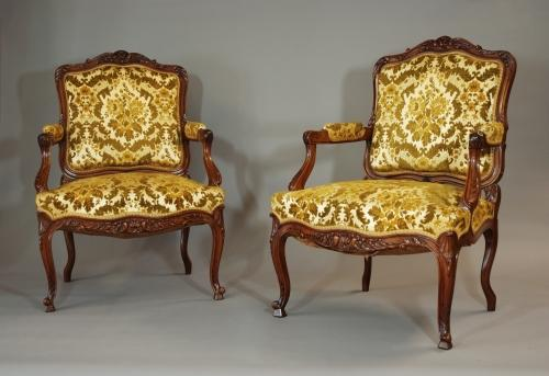 Pair of French late 19thc walnut fauteuils