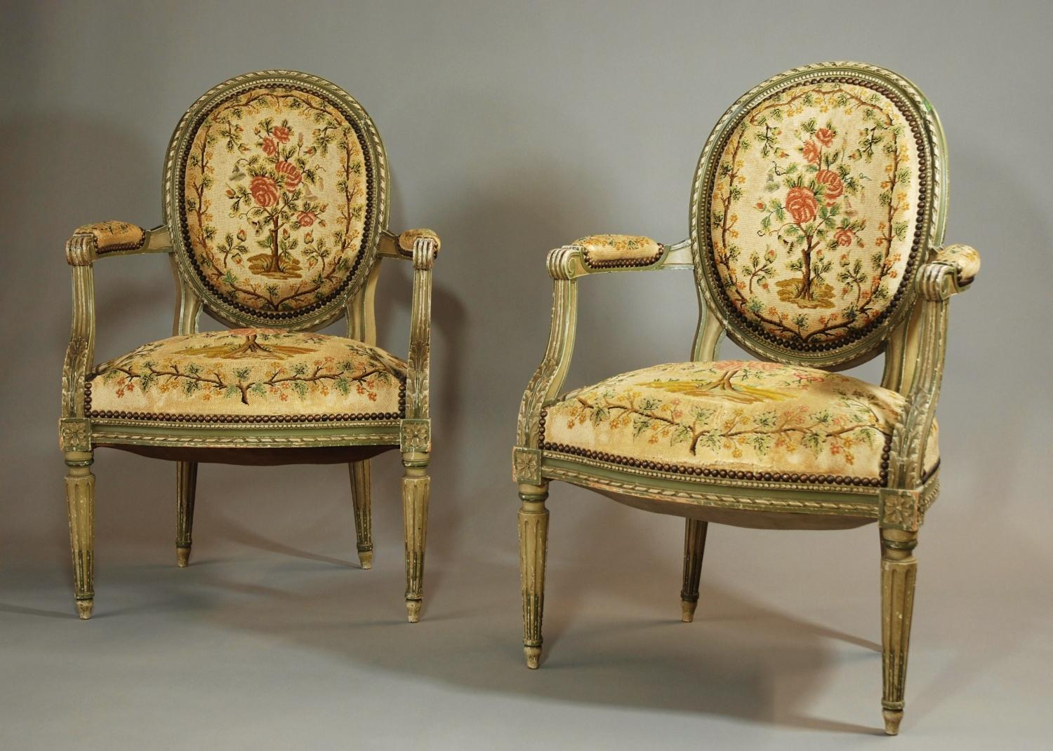 Pair of French painted open armchairs