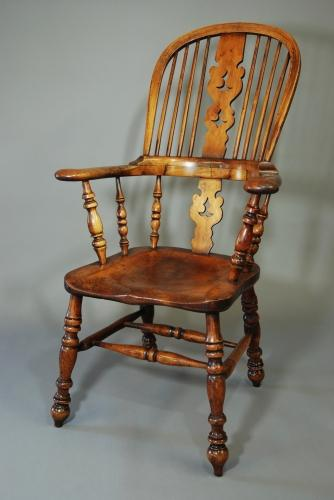 Broad armed fruitwood high back Windsor chair