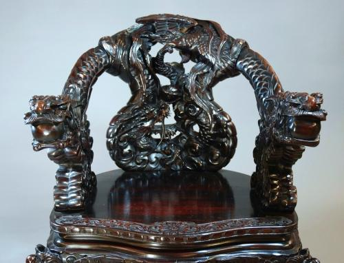 Pair of heavily carved Chinese dragon chairs