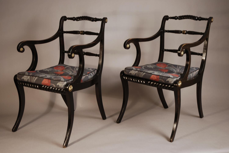 Pair of Regency ebonised open armchairs