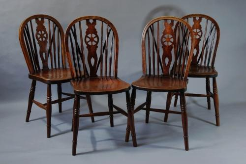 Set of four 19thc wheelback windsor chairs