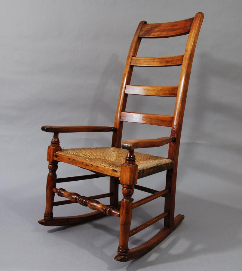 Birch ladder back rush seated rocking chair