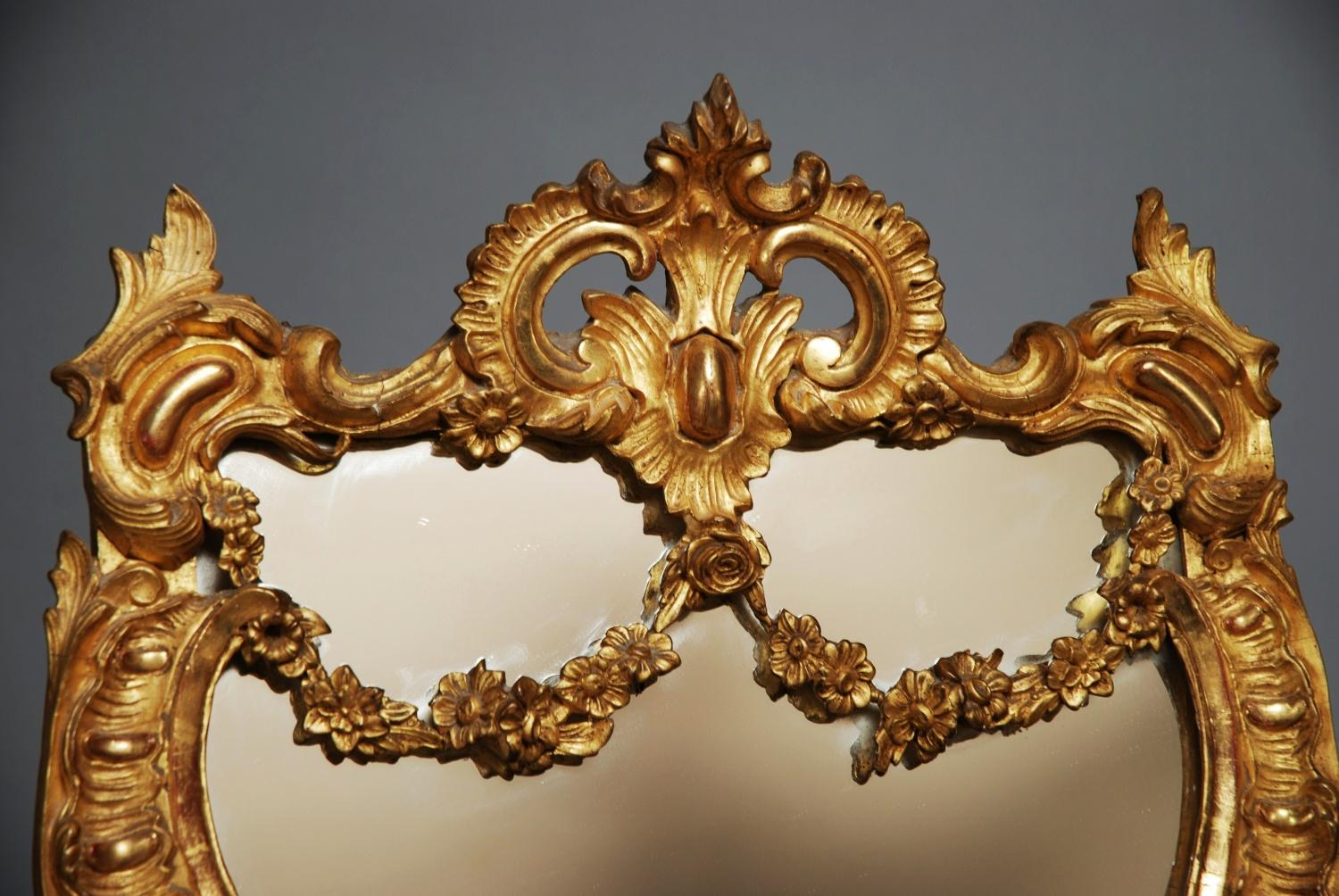 A late 19thc gilt wood and gesso mirror