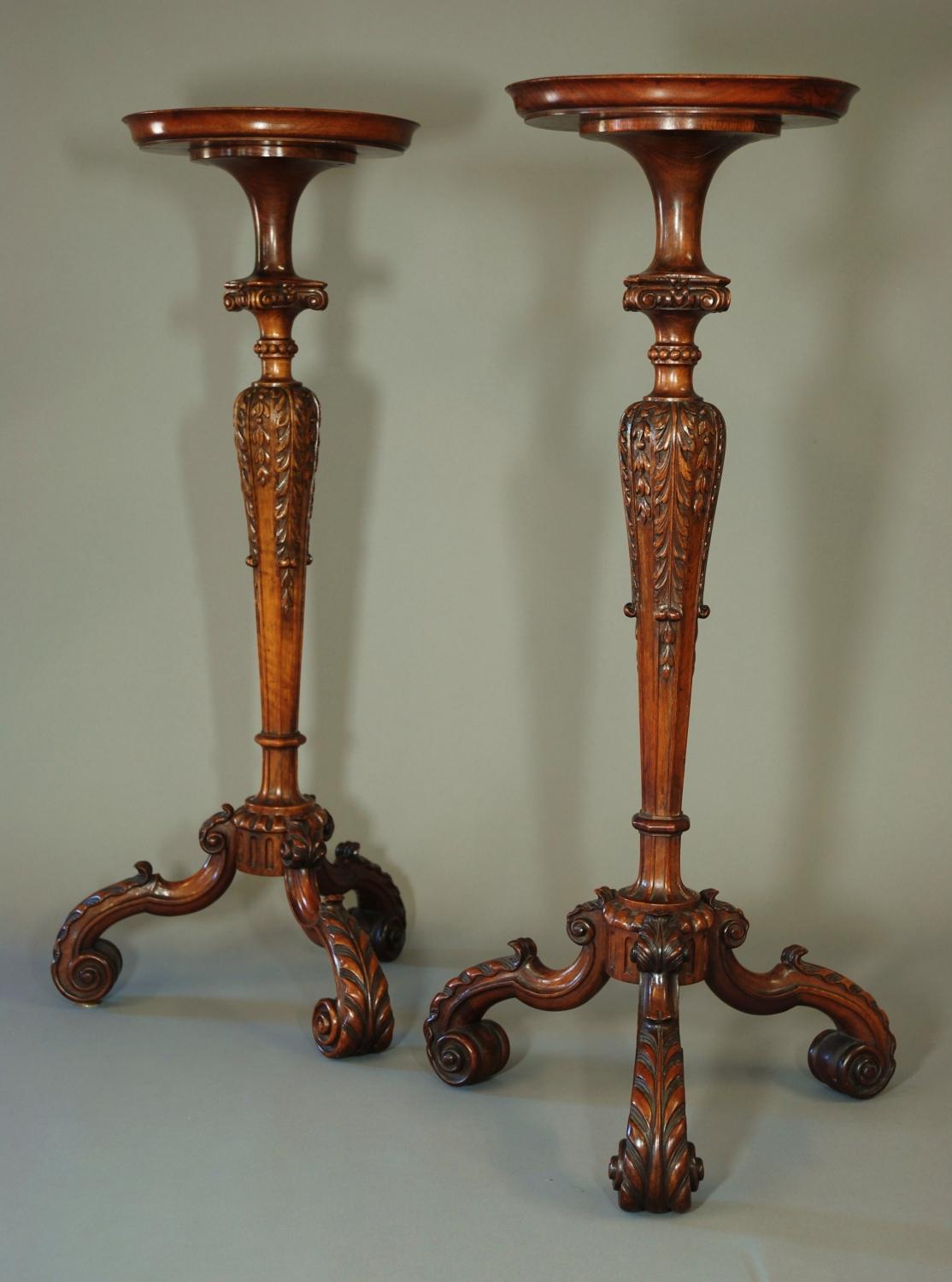 Pair of carved walnut torcheres