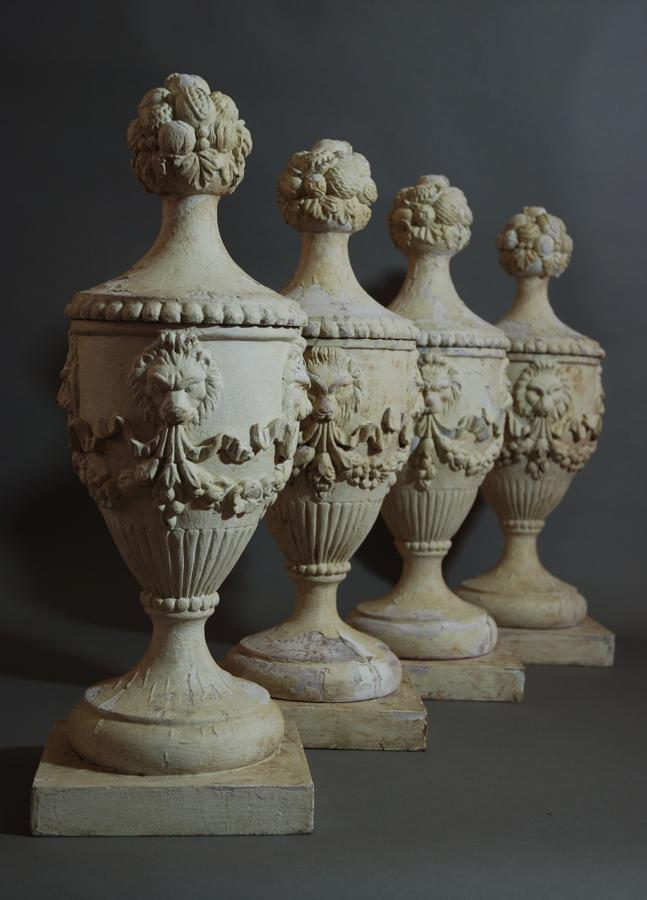 Set of four carved & painted wooden urns