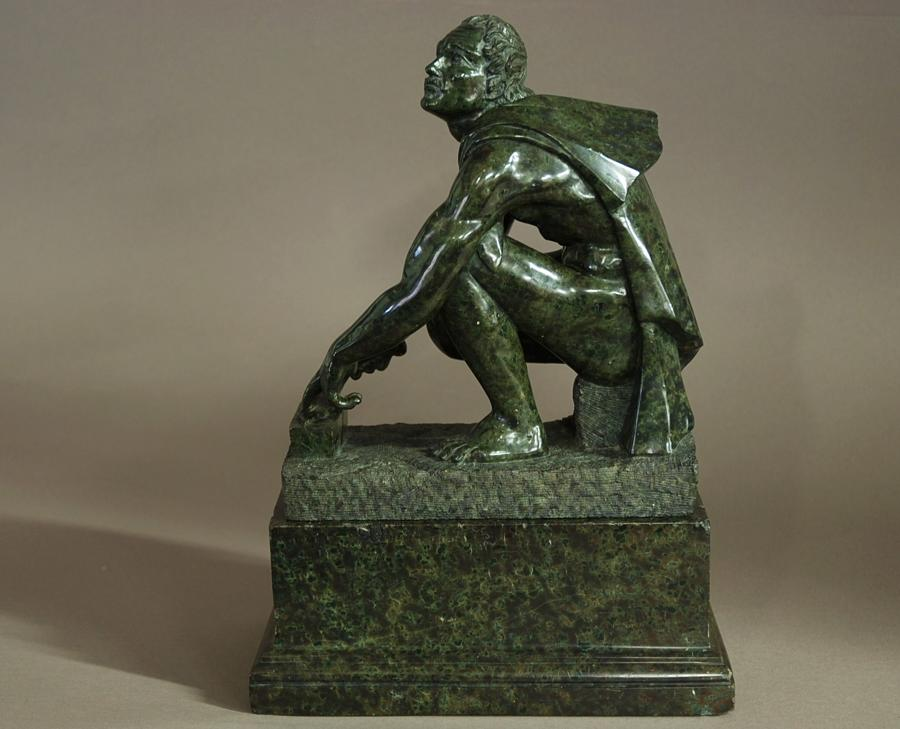19thc Serpentine figure of Knife Sharpener