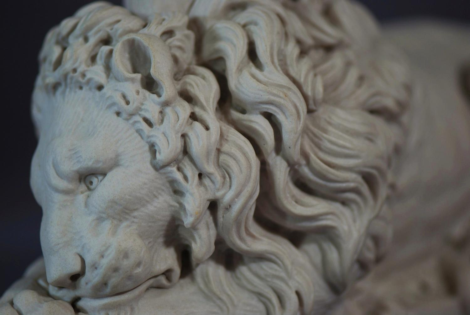 Pair of composition 20thc lions