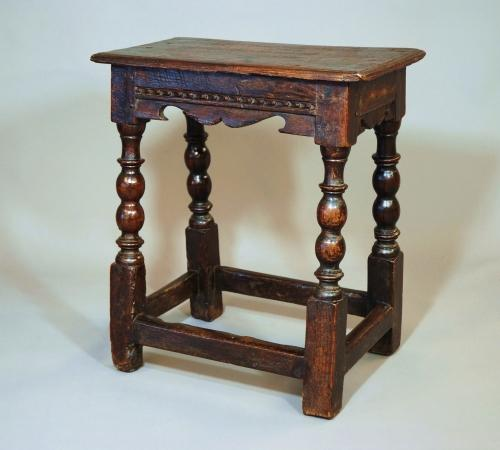 A rare early 17thc oak joint stool