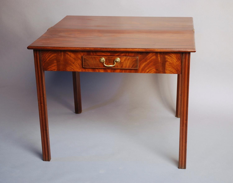 Mid 18thc mahogany tea table of good patina