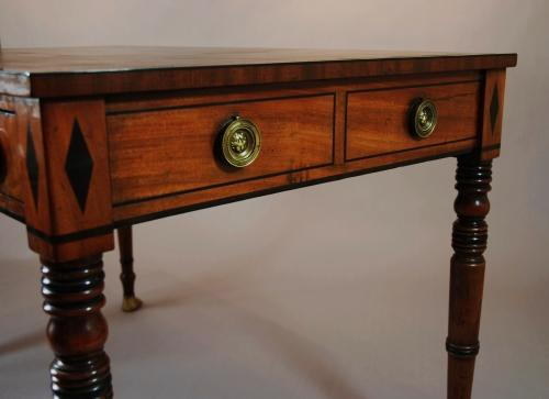 Regency two drawer mahogany writing table