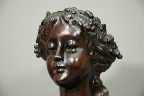 Carved wooden figure of a young bacchante