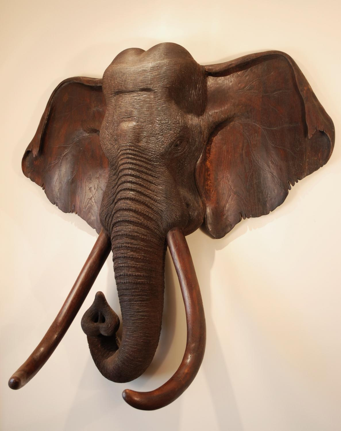 Large thc carved wooden elephant head in wood carvings