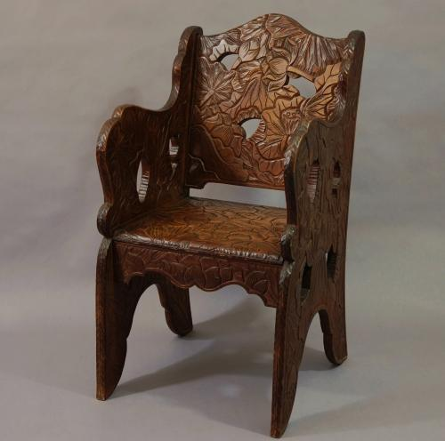 Early 20thc carved walnut armchair