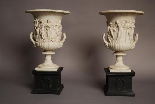 Pair of highly decorative classical urns