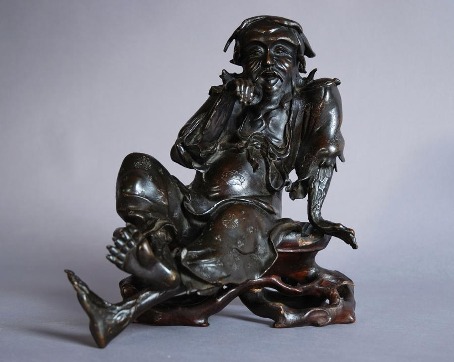 Chinese bronze of seated old man, signed