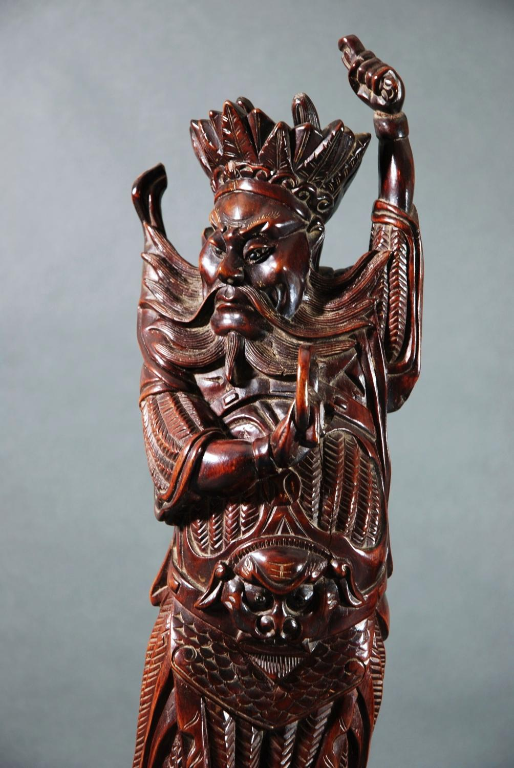 Chinese carving of mortal with headdress