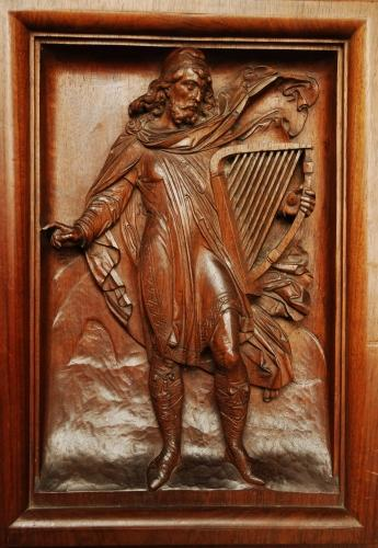 19thc carved walnut panel of Medieval man
