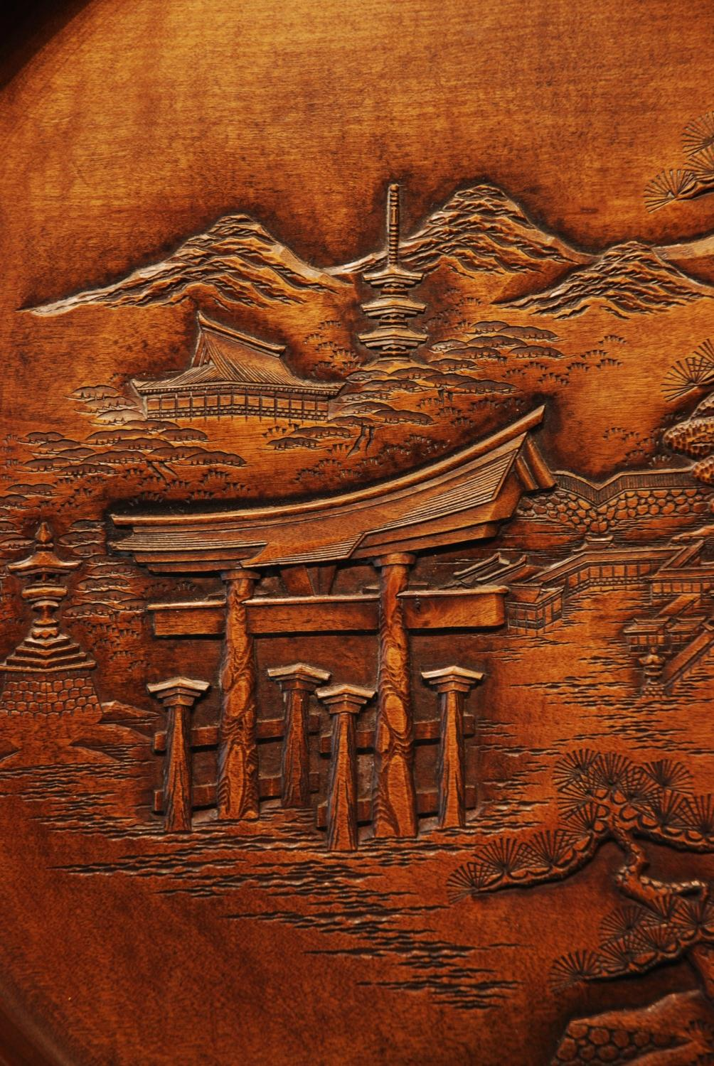 Finely carved wooden japanese plate in wood carvings