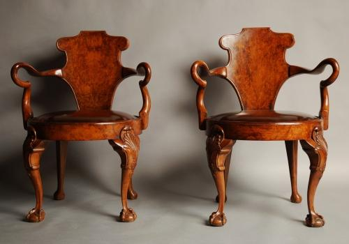 Pair of walnut open arm library chairs