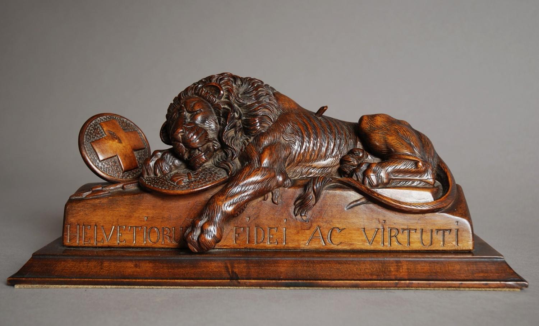 Black Forest linden wood carving of a lion