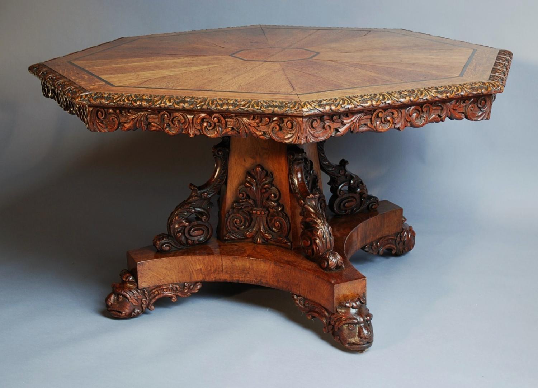A 19th century oak octagonal tilt top table