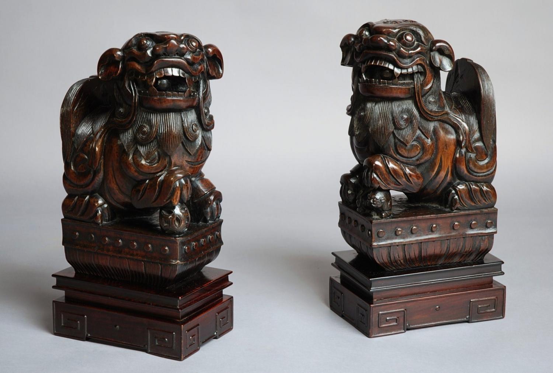 Pair of Chinese hardwood Fu Lions
