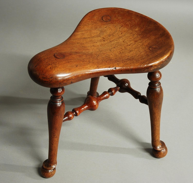Late 19thc walnut saddle seat stool