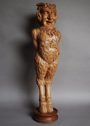 Large Continental carved satyr figure