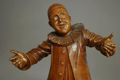 Finely carved walnut figure of a Pierrot
