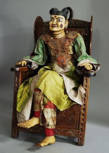 Decorative articulated wooden Burmese puppet