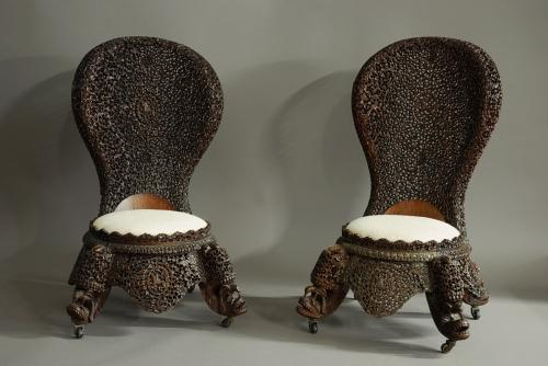 Pair of Burmese hardwood carved low chairs