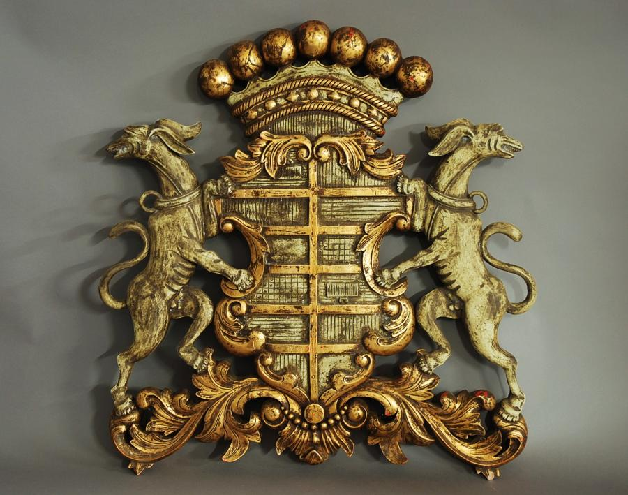 Carved wooden coat of arms
