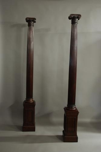 Pair of decorative walnut Ionic columns