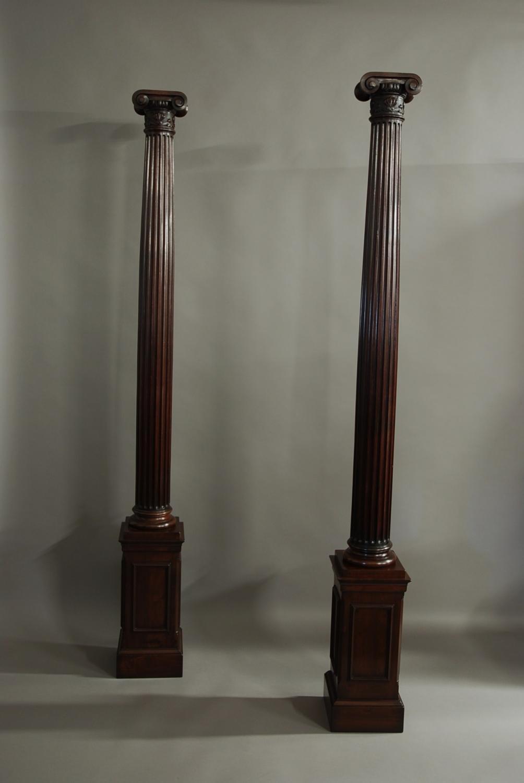 Pair of decorative walnut Ionic columns