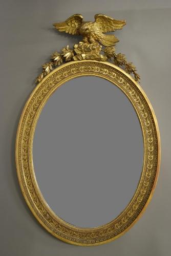 Late Regency large oval gilded mirror
