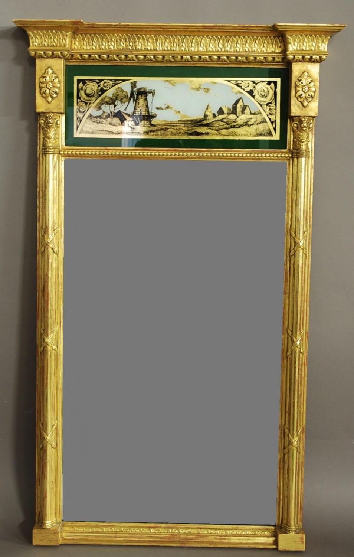 Regency style eglomise giltwood pier mirror