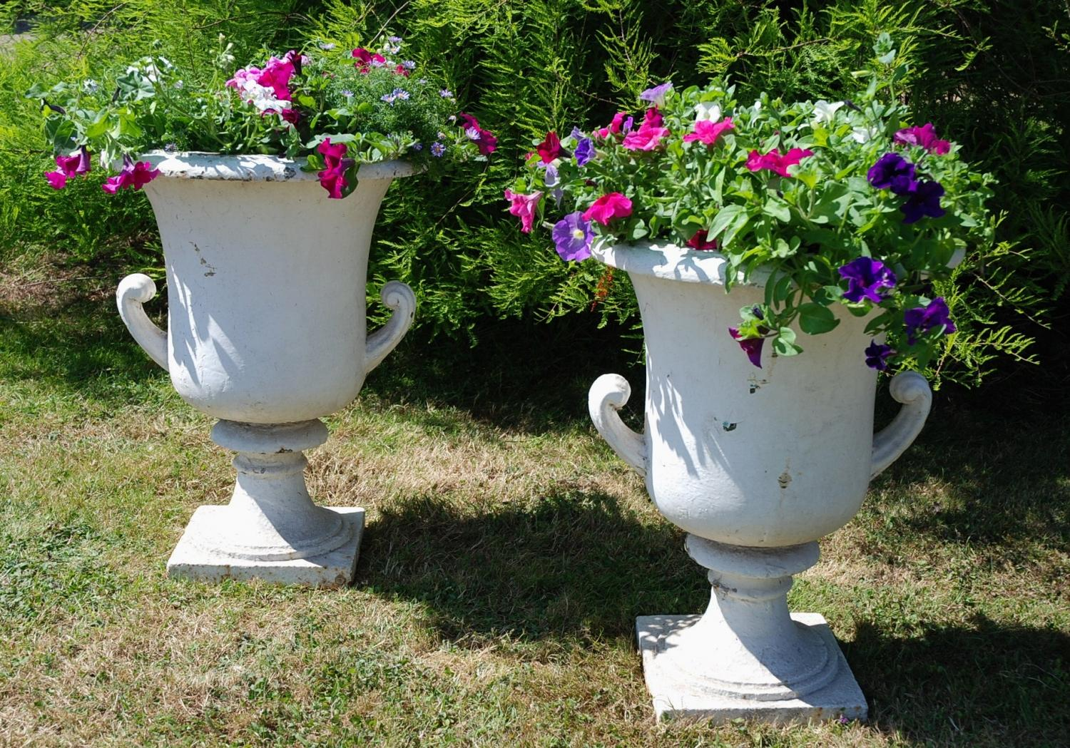 Large pair of 19th century cast iron urns