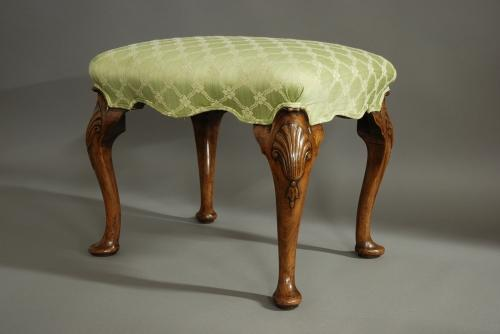 Queen Anne style walnut cabriole leg stool