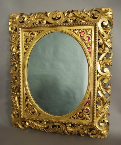 Florentine carved gilt wood mirror