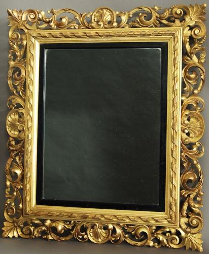 Late 19thc Florentine carved gilt wood mirror