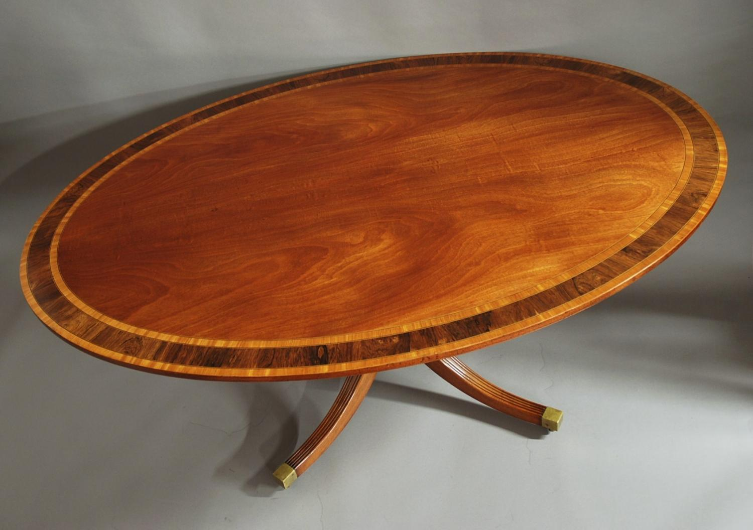 Superb quality mahogany oval breakfast table
