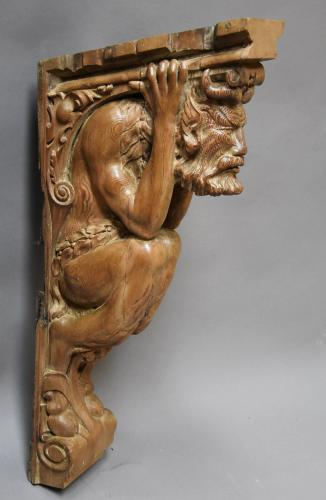 Large superbly carved 19thc pine satyr bracket