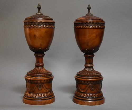 Decorative pair of carved wooden urns