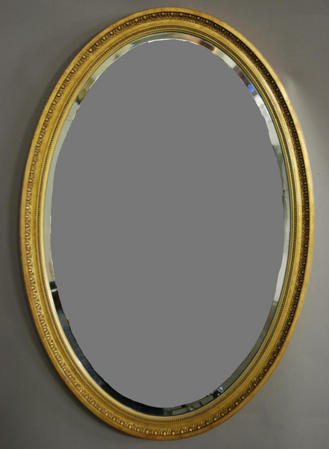 Early 20th century oval giltwood mirror
