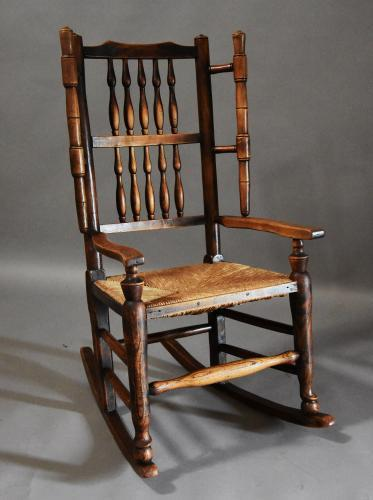 Mid 19th century ash rocking/nursing chair