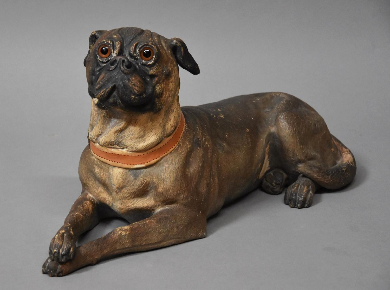 19thc Austrian reclining terracotta Pug dog