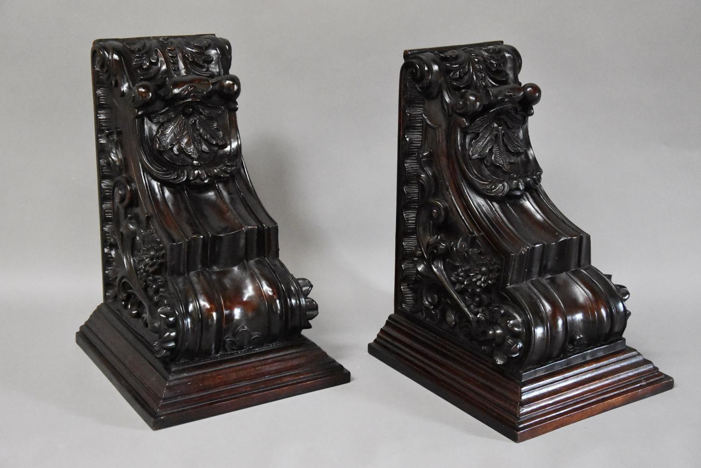 Large pair of decorative mahogany brackets