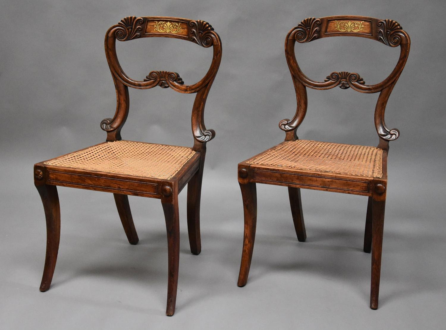 Pair of simulated rosewood Regency chairs