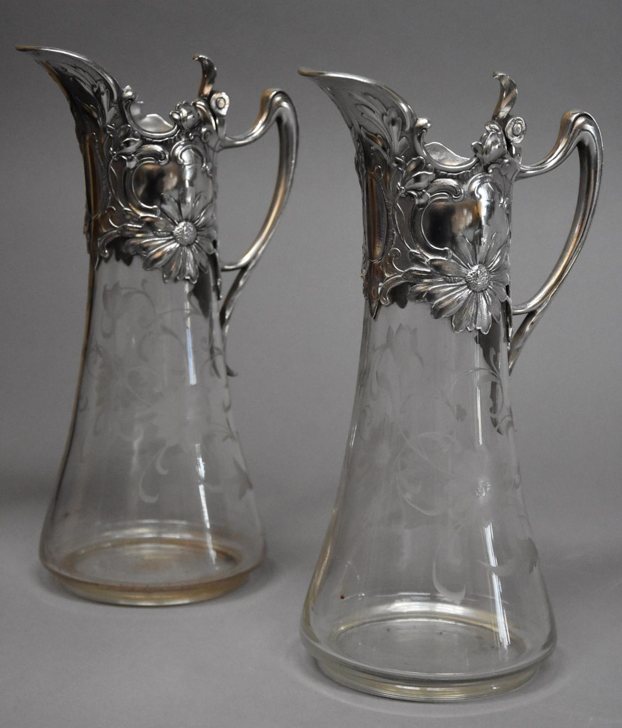 Pair of late 19thc Art Nouveau claret jugs